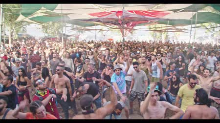 nightclub : KINERET, ISRAEL, April 6 2018- People dancing in a nature trance party