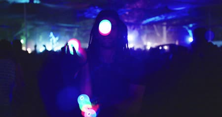 abilities : Man juggling with light balls during a night party Stock Footage