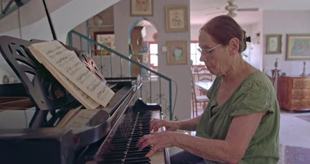 muse : Old woman playing a grand piano at her home Stock Footage