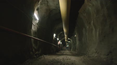 train tunnel : Walking POV shot inside a large dark construction tunnel Stock Footage