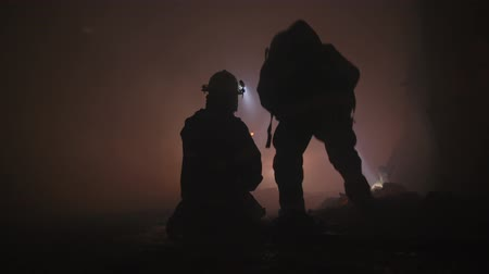 el feneri : Firefighters during a rescue operation in a dark tunnel filled with smoke Stok Video