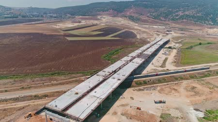 yüksek çözünürlüklü : Aerial footage of large highway construction project with tunnels and bridges Stok Video