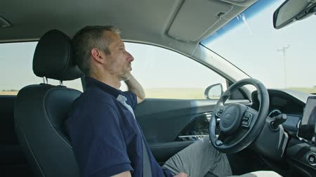itself : Male driver sitting in an autonomous car, letting the car drive by itself