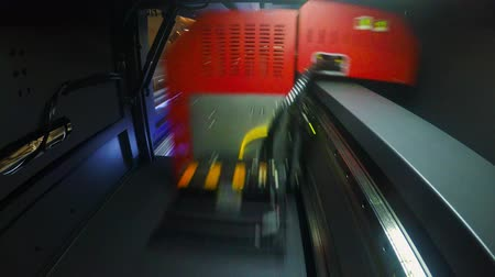 printings : POV shot inside a large format printer printing at high speed Stock Footage
