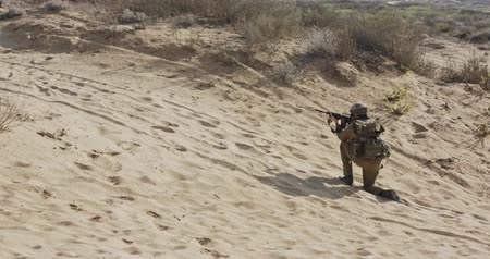 special unit : Soldier running on a sand hill during combat, under fire