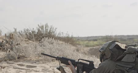 special unit : Israeli soldier taking cover from enemy fire during combat Stock Footage