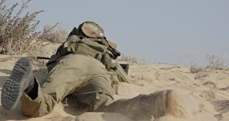idf : Israeli soldier taking cover from enemy fire during combat Stock Footage