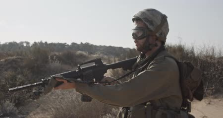 special unit : Slow motion of an israeli soldier walking with a rifle on a sand hill Stock Footage