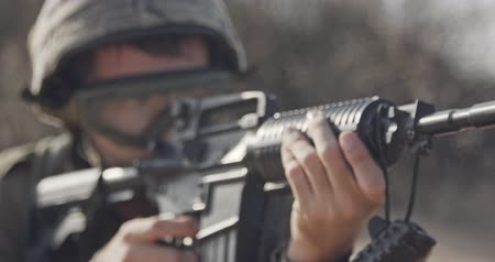special unit : Close up of an Israeli soldier poiting his rifle looking for enemies