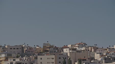 rock wall : Overview of an Arab city in Israel with a large mosque rising above