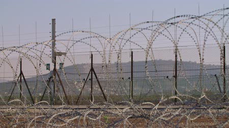 apartheid : Border fence between Israel and West Bank. barbed wire electronic fence.