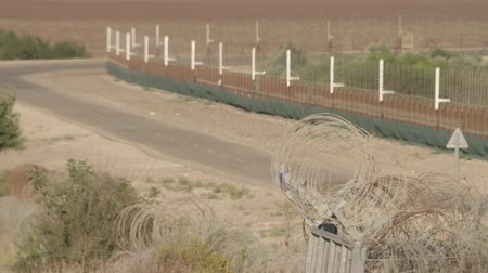 clash : Border fence between Israel and West Bank. barbed wire electronic fence.
