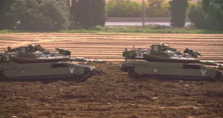 idf : Gaza, March 30, 2019. IDF tanks lined up in combat formation near the border