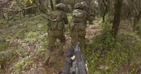 armed : Weapon POV footage of a squad of Israeli commando soldiers during combat Stock Footage