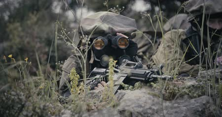 idf : Israeli soldiers in a surveillance and reconnaissance mission using binoculars Stock Footage