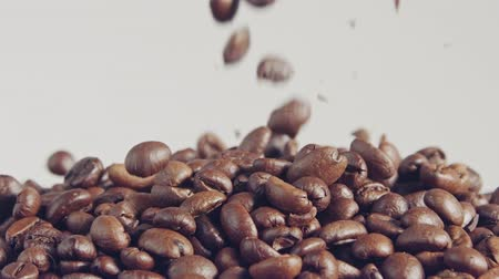 hessian : slow motion of coffee beans falling into a burlap sack