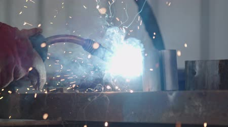 hegesztés : Slow motion of a welder welding construction steel frames