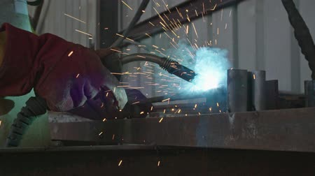 kaynakçı : Slow motion of a welder welding construction steel frames