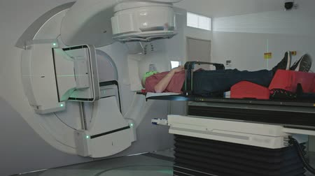 ionizing : Patient Getting Radiation Therapy Treatment Inside A Modern Radiotherapy Room