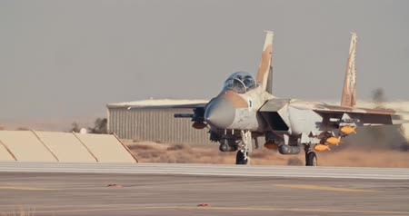 bomber : Israeli Air Force F-15 taxiing on the runway before takeoff