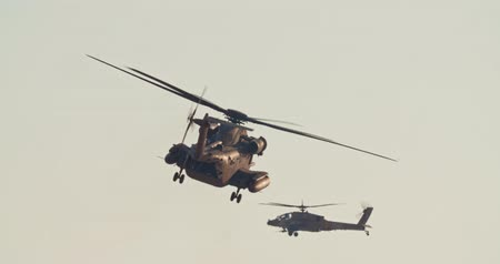 two forces : Military helicopter during a rescue mission in a base Stock Footage