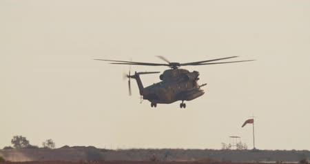 авиашоу : Military helicopter during a rescue mission in a base Стоковые видеозаписи