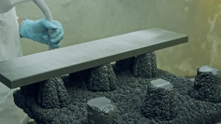meubelmaker : Slow motion of a worker painting kitchen wood doors using spray paint