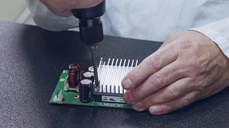 soldering iron : Close up of Manual assembly of electronic components on a board