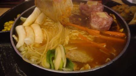 tofu : Hot Korean noodle is boiling in a pot