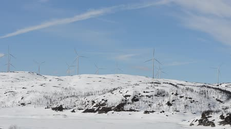 regenerating : windmill farm on mountain on sunny blue sky day