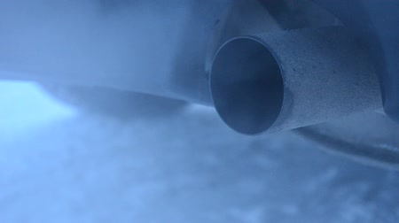 escape : Exhaust coming out from tailpipe on a idling parked car