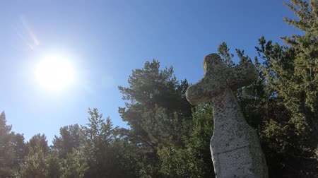 ukřižování : traveling on a granite cross and shining sun in the French Pyrenees, Aude in southern of France