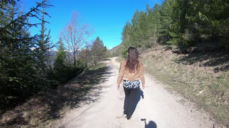 occitania : young single woman walking on a path in the Pyrenees, Aude in southern France