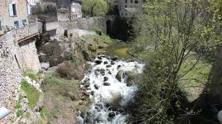 occitania : Pyrenean river and village in Aude, Languedoc in southern of France
