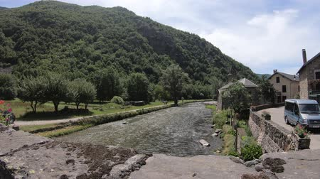 capcir : Pyrenean bridge over river  and village, Orlu valley in Ariege, Midi Pyrenees in southern of France