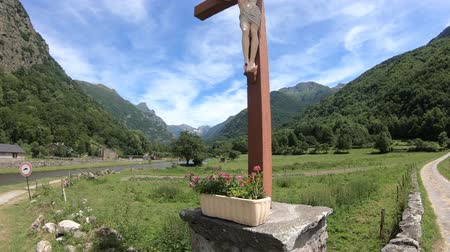 crucified : Cross of jesus in front of pyrenean mountains, Ariege in southern of France