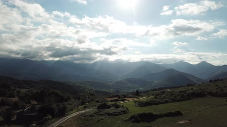 Aerial view of pyrenean mountains with shining sun, Ariege in the southern of France