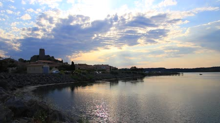 time lapse of mediterranean village of Guissan and marine pond at sunset  , Aude in the south of France