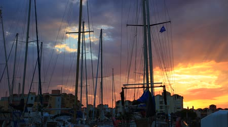 Time lapse of pleasure boat in the port of Gruissan at sunset in the Aude. Languedoc in the south of France Stock Footage
