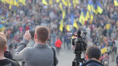 obránce : Kyiv, Ukraine 14 oct 2019. Maidan. Camera man shooting footage on protest against Minsk Protocol and Steinmeier Formula