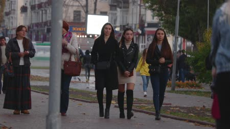 удовлетворенный : Chernihiv, Ukraine. 13 oct 2019. Teenage Girls Or Friends Walking In Autumn City Park