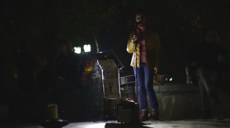 dobos : Chernihiv, Ukraine. 13 oct 2019. Musicians performing at the park near historical center Rampart. Night, late evening