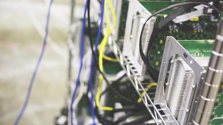 cryptocurrency : Row of bitcoin AntMiners set up on the wired shelfs.
