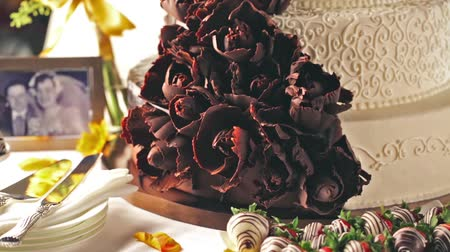 tiered : Gourmet tiered wedding cake as centerpiece at the wedding reception.