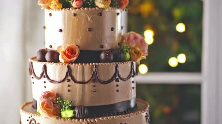 perene : Gourmet tiered wedding cake at wedding reception.