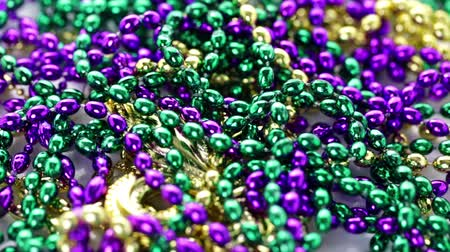 бисер : Multicolored decorations for Mardi Gras party on the table.