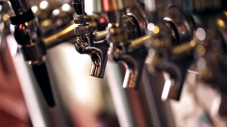 bares : Close up of beer lines for draft beer in restaurant.