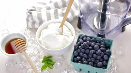 shovívavost : Ingredients to make smoothie with plain yogurt and fresh berries on the table.