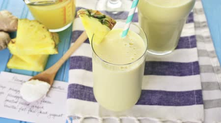 ananas comosus : Freshly made pineapple ginger smoothie with Greek yogurt and juice.