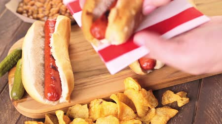 sekaná : Grilled hot dogs on a white hot dog buns with mustard and ketchup.
